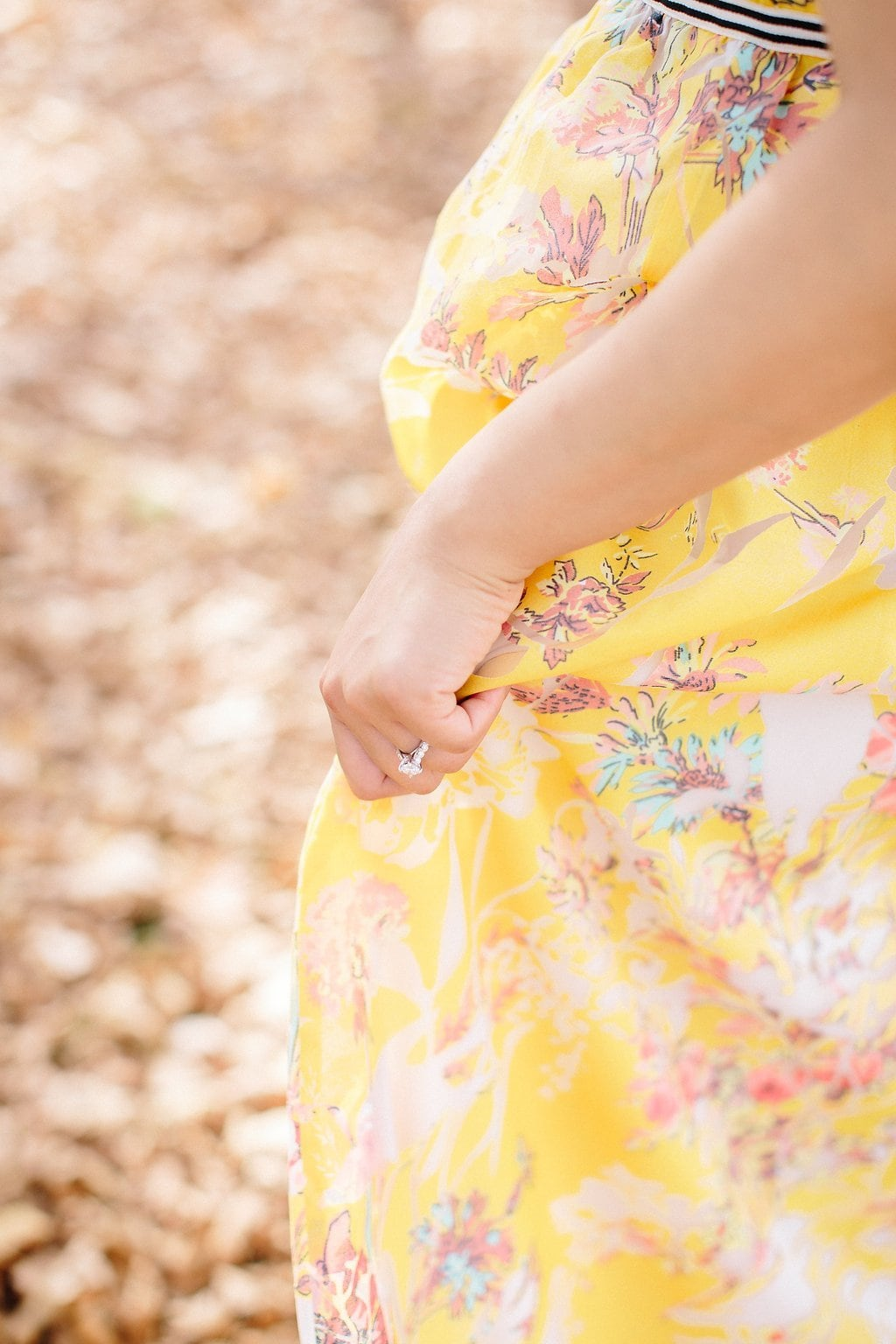 Close up of bride's bring wearing yellow anthropologie dress
