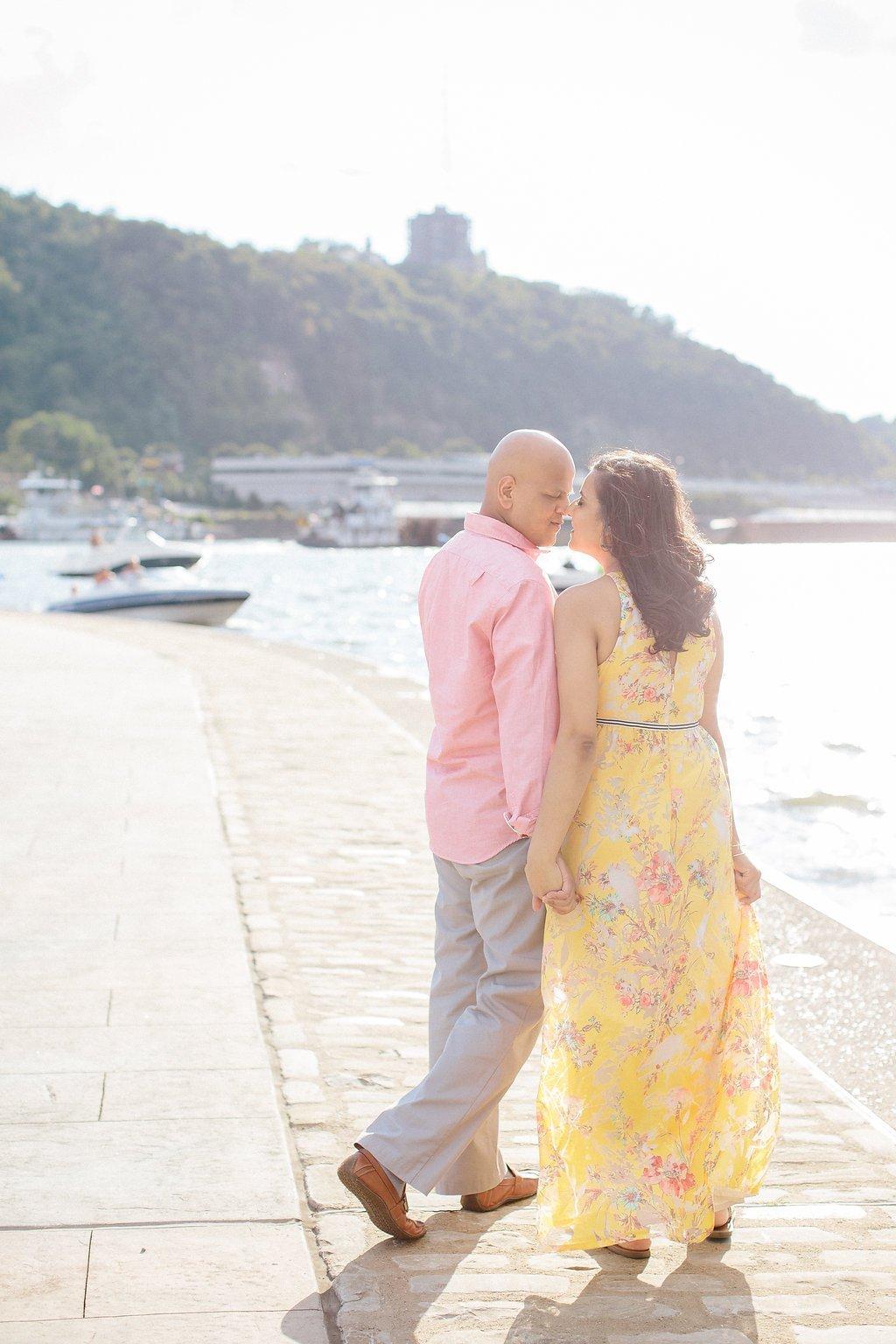 Bride and groom walking along the riverwalk