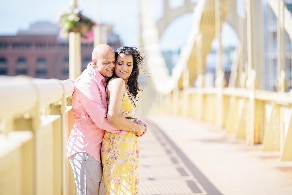 couples walking down the Clemente bridge