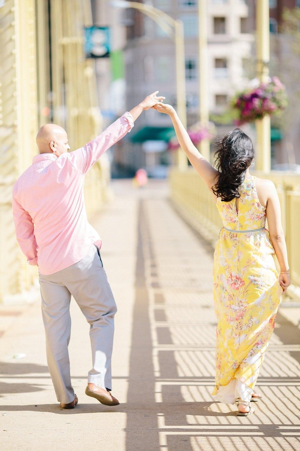 Bride and groom dancing on the Roberto Clemente Bridge