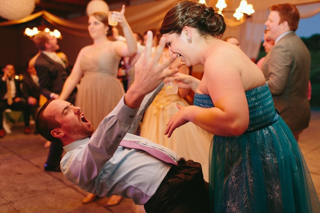 Wedding guest dancing at a barn reception