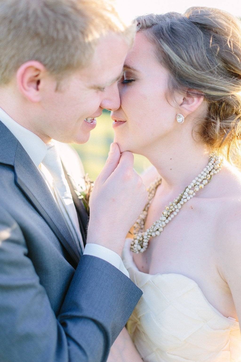 bride and groom sharing a kiss during their bridal portraits