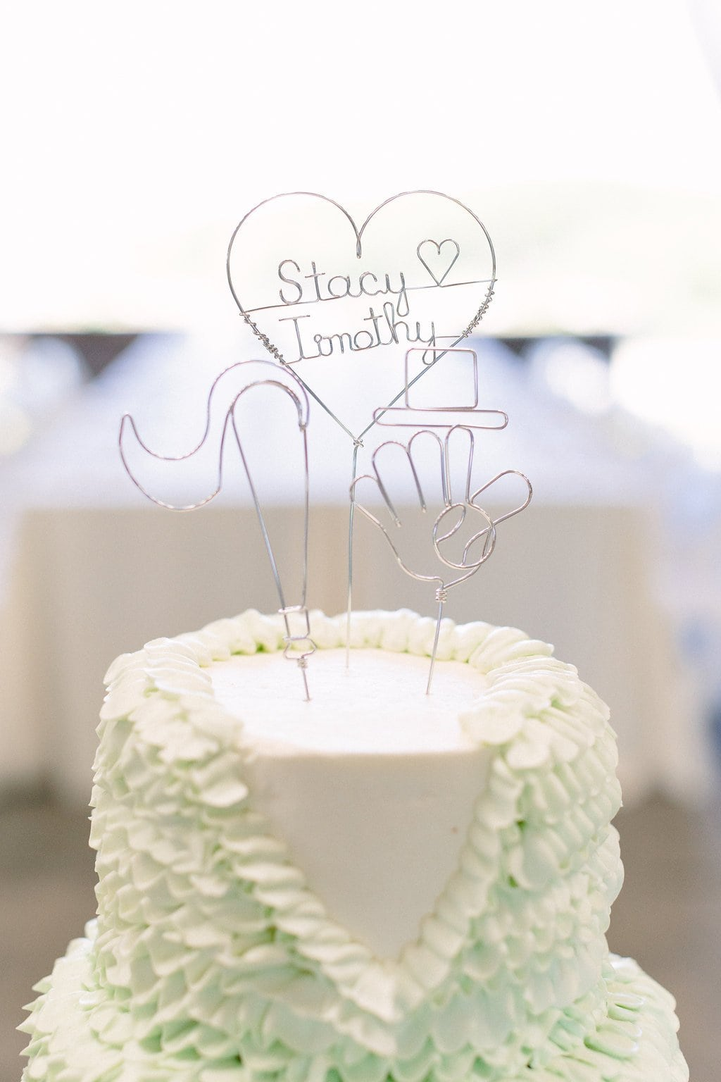 close up of wedding cake topper