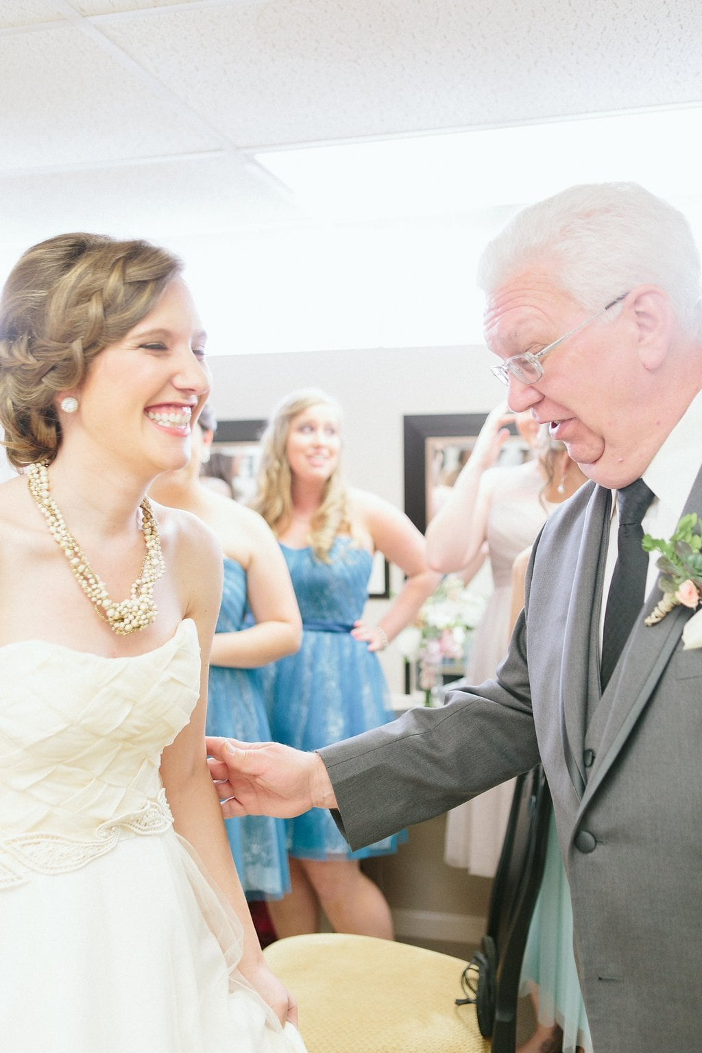 father of the bride shares moment with his daughter