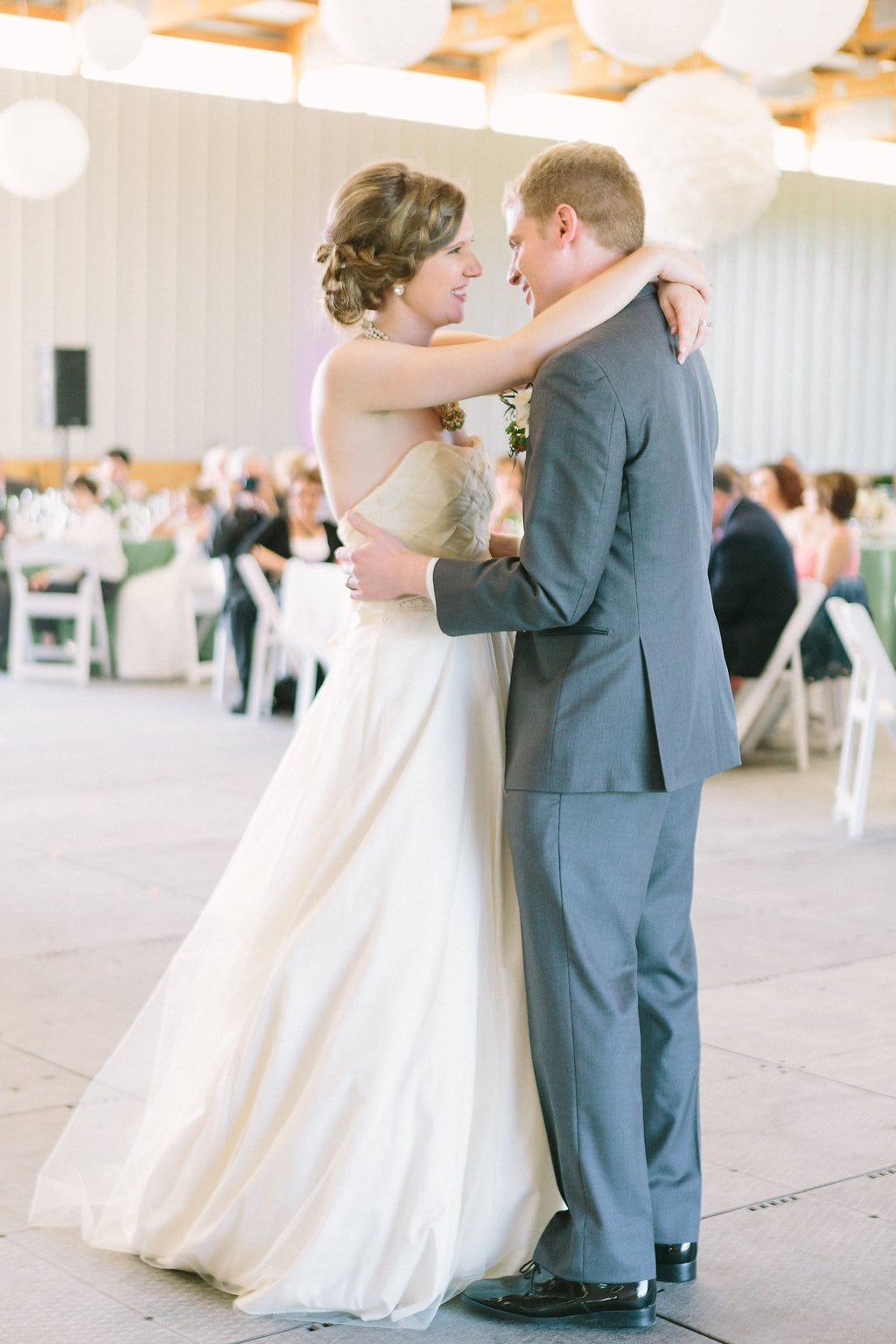 Bride and groom dancing inside the barn on a farm