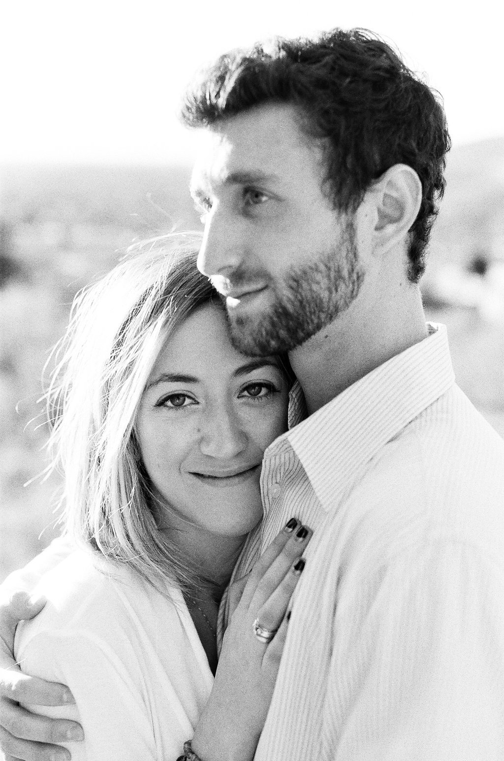 Couple embracing in black and white photo