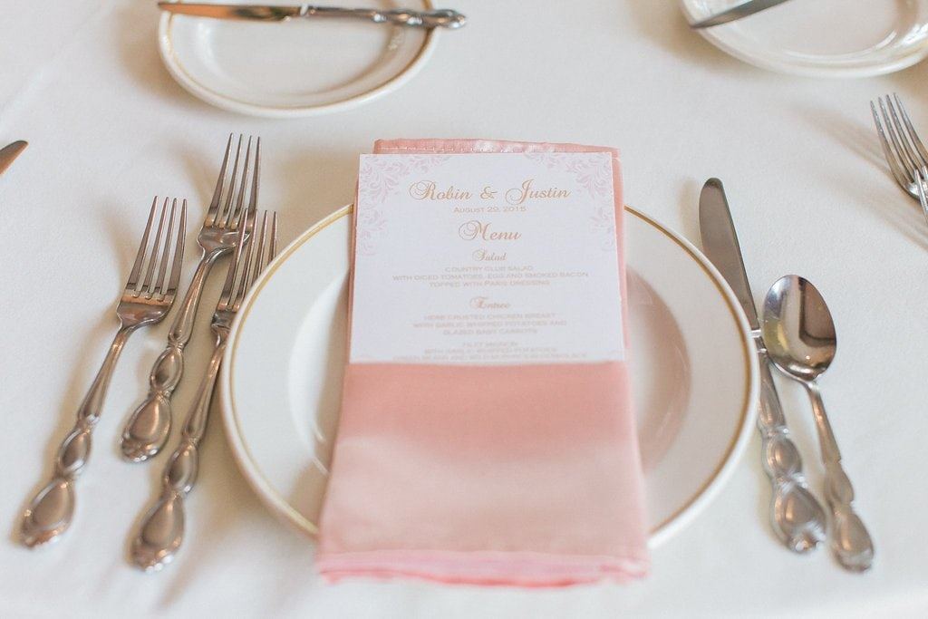 table setting with pink napkin