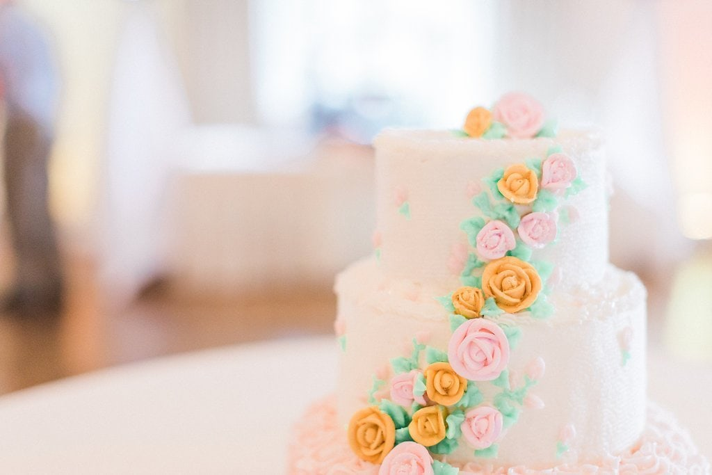 wedding cake with pink and orange icing flowers