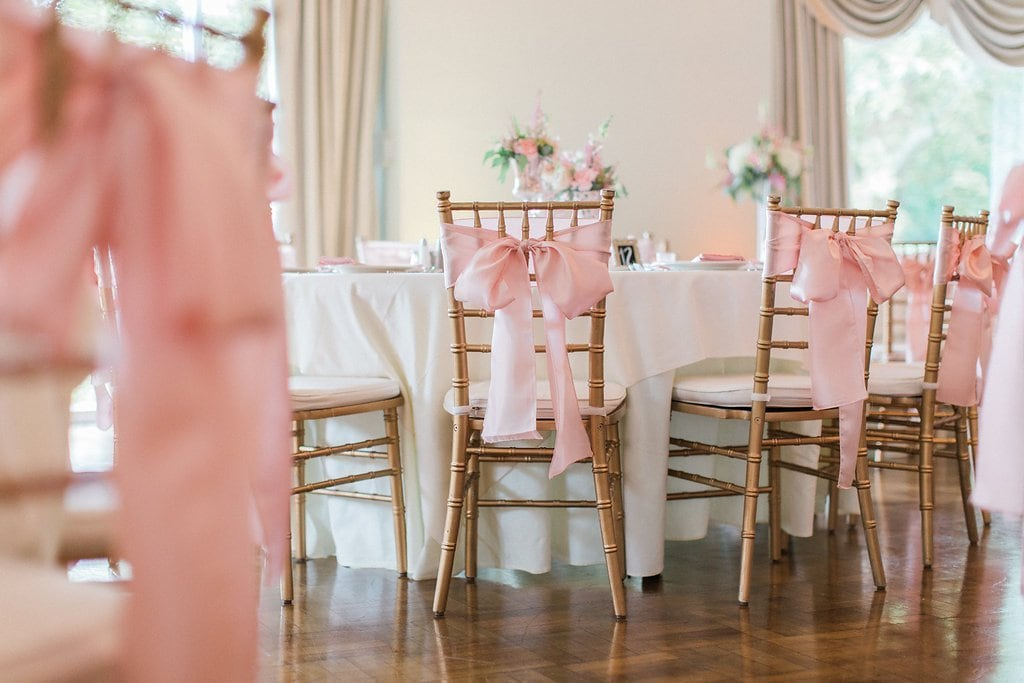 gold chiavari chairs with pink silk bows