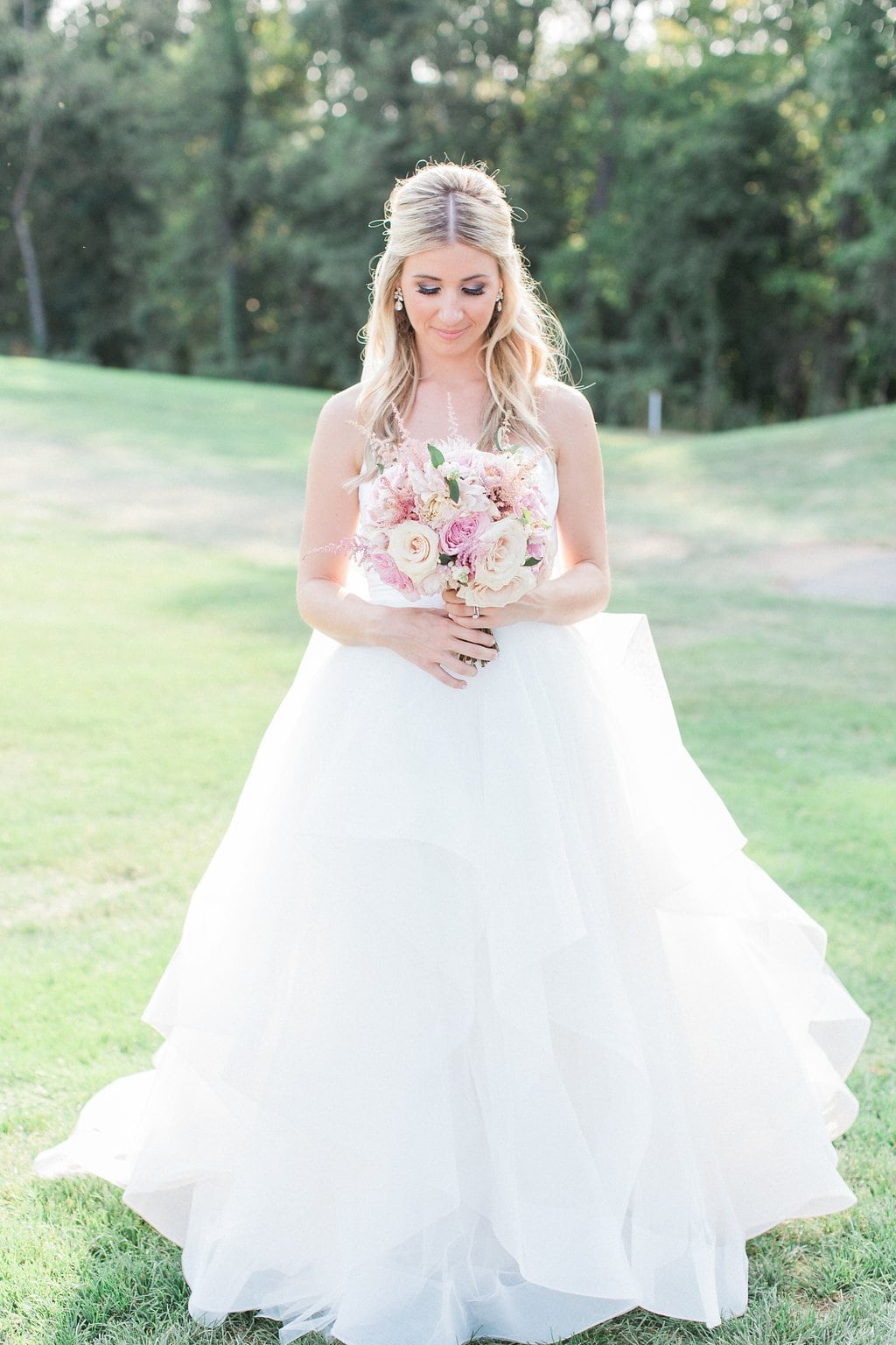bride in hayley paige dress and pink bouquet