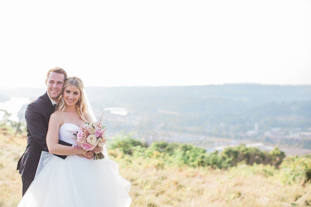 bride and groom portraits overlooking the city of Pittsburgh
