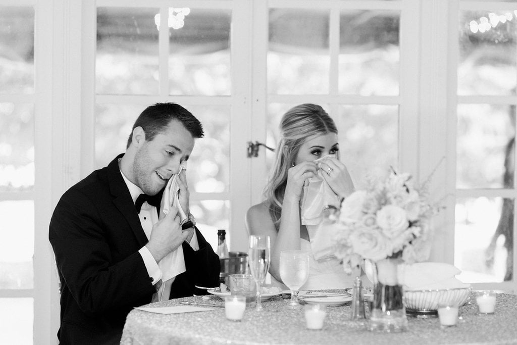bride and groom both crying during speeches at wedding reception