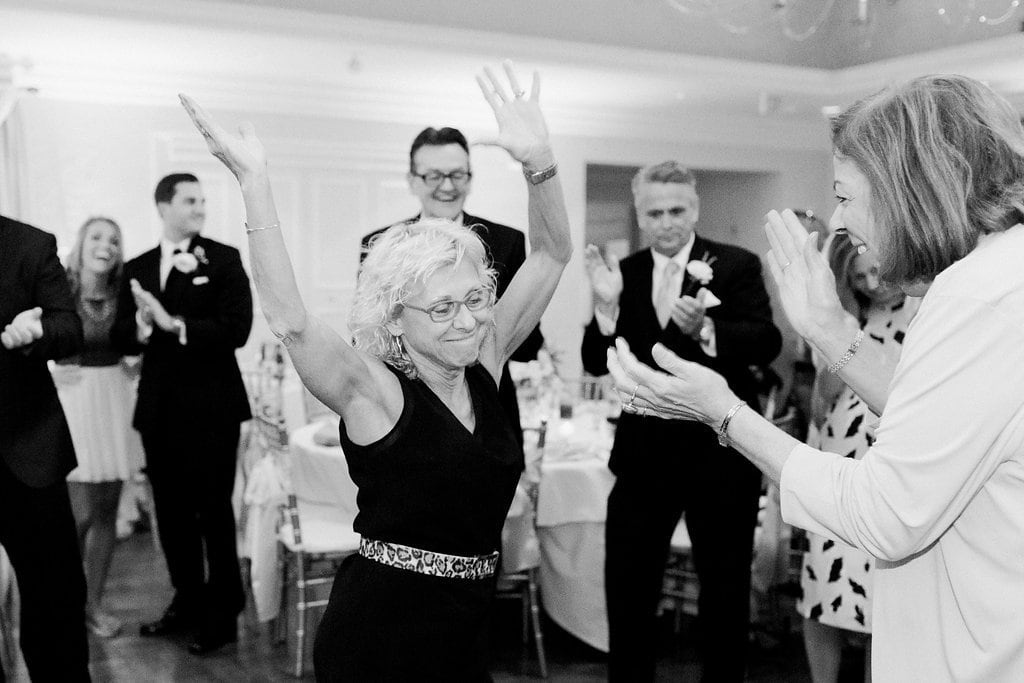 black and white photo of guests dancing at wedding reception Longue Vue Country Club Wedding