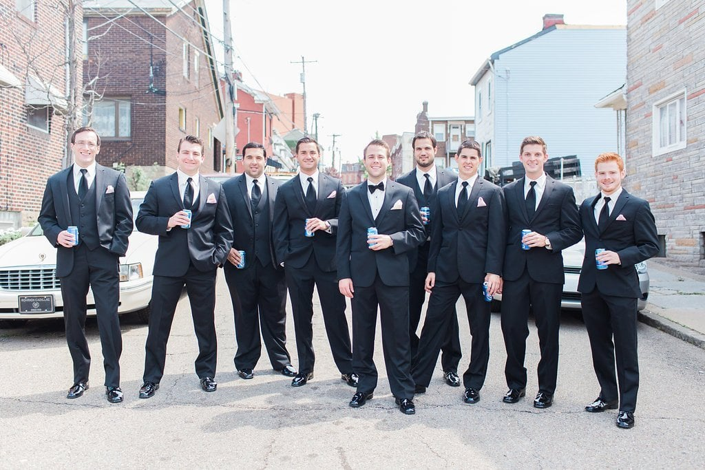 groom with his groomsman walking to their wedding ceremony