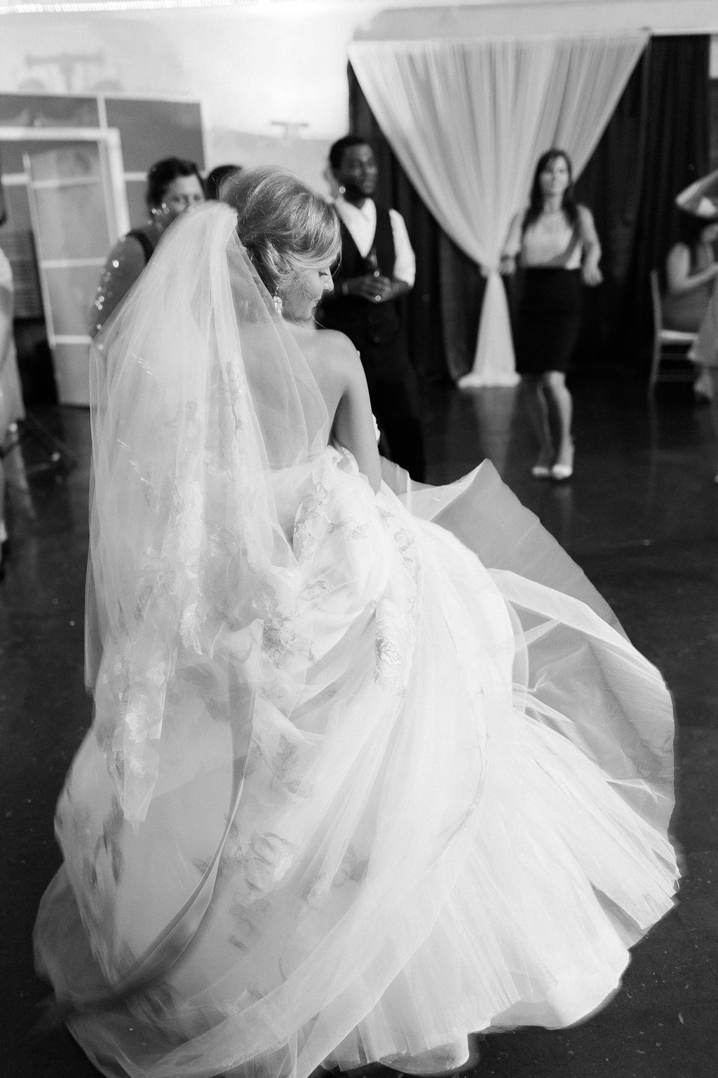 Bride dancing on the dance floor black and white photo