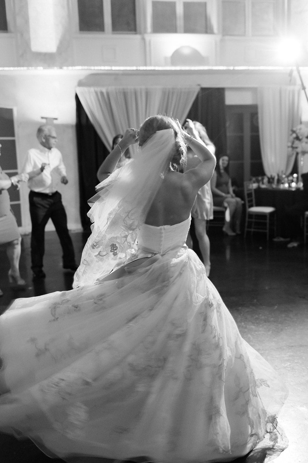 Bride dancing with guests on the dance floor