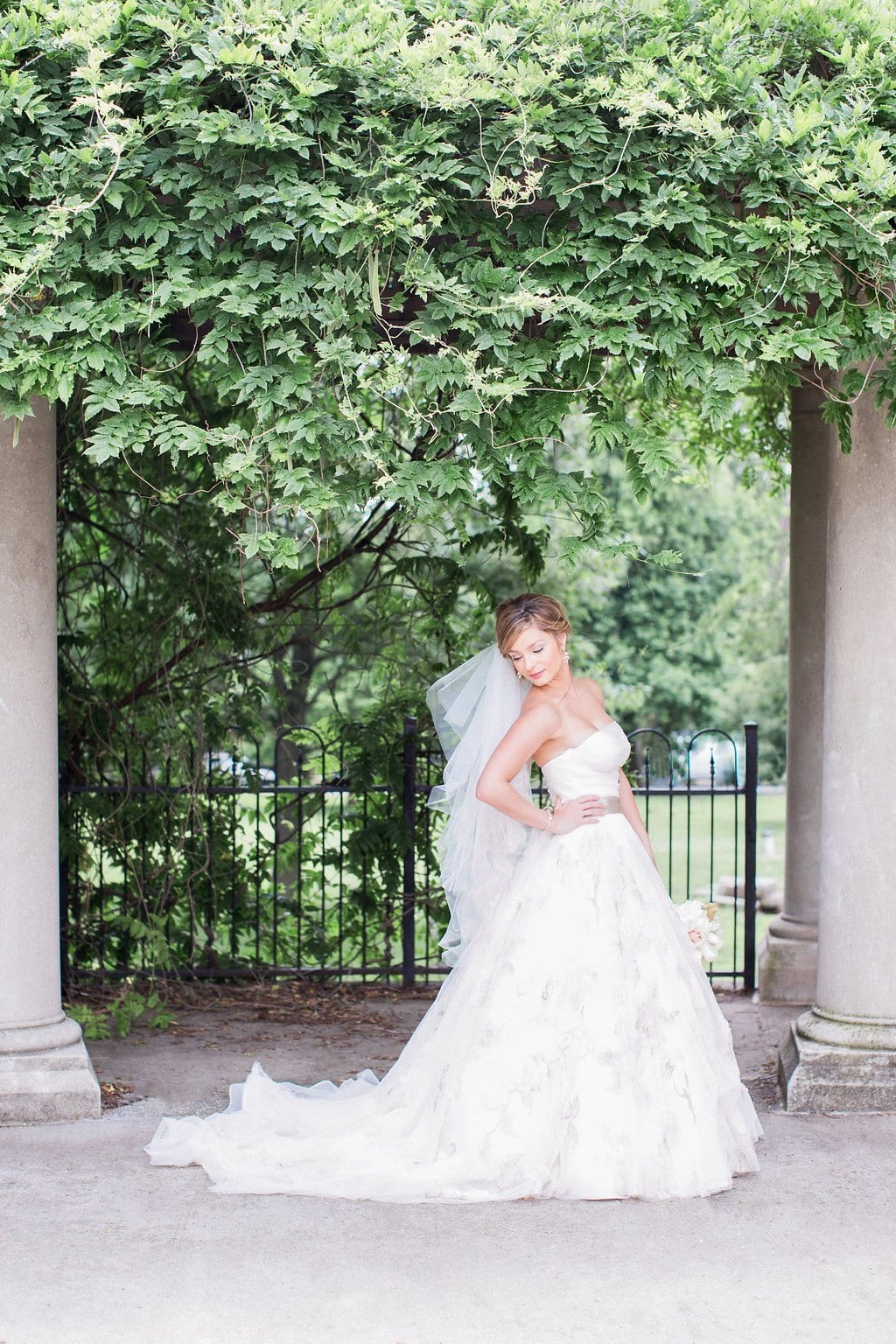 Bridal portraits under an arbor in downtown Columbus park