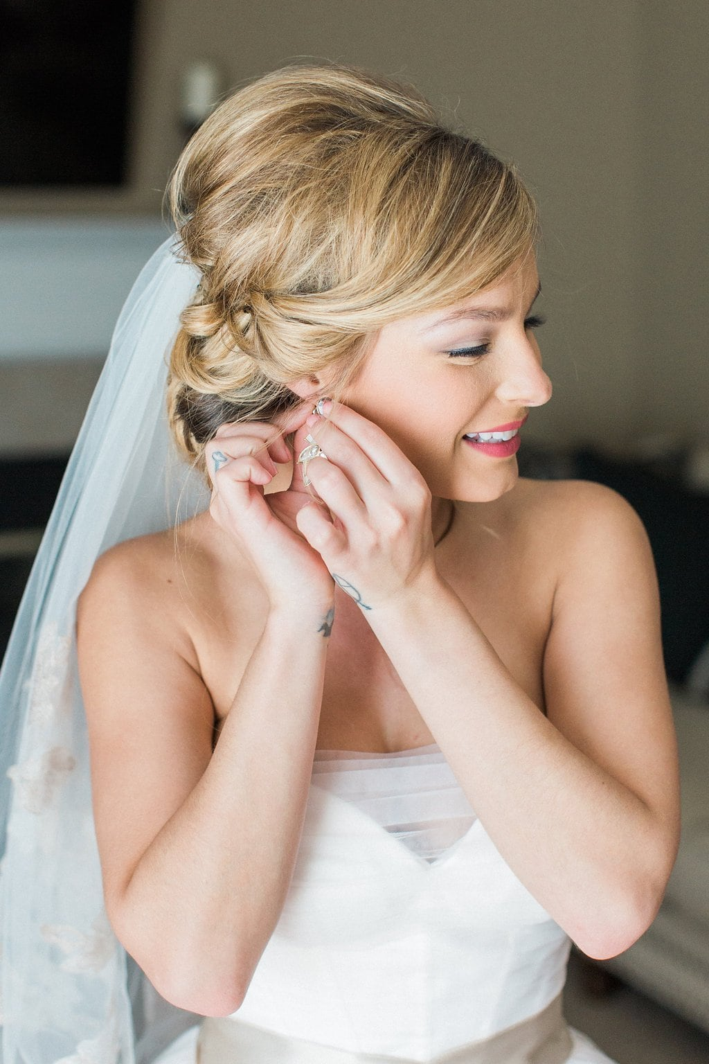 Bride putting her earnings in and final touches