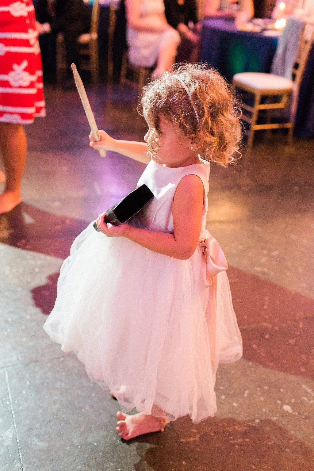 Little girl dancing at wedding reception