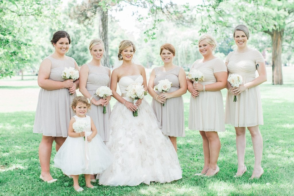 Bridesmaids in grey dresses in the park