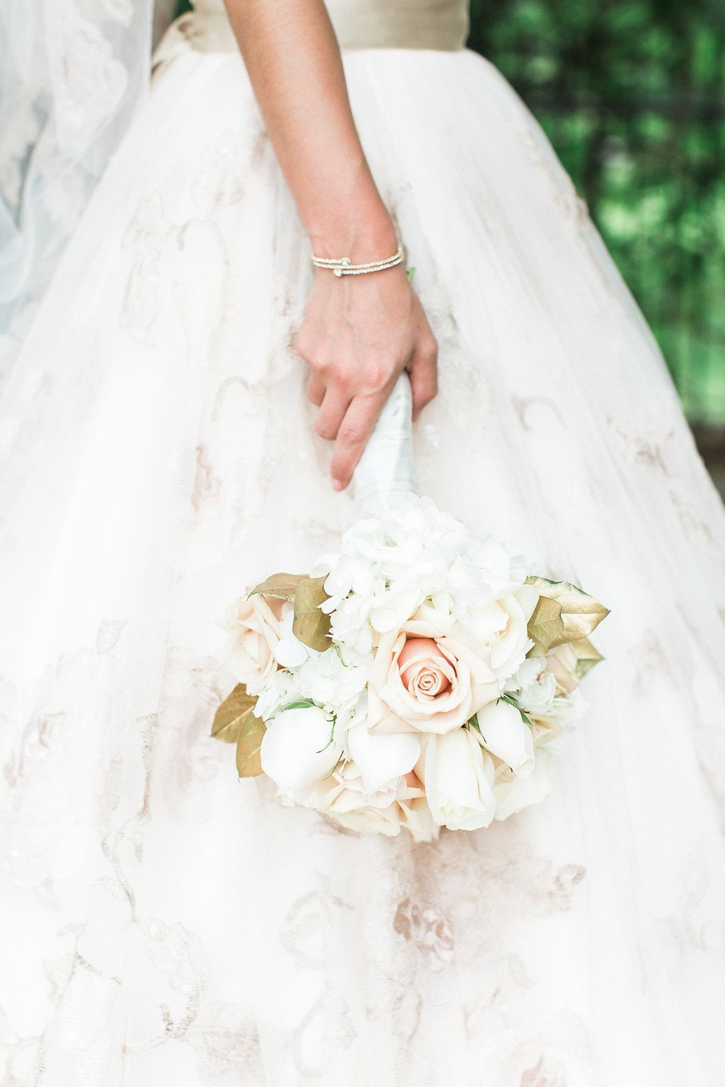 Close up of bride's pink and white bouquet during portraits