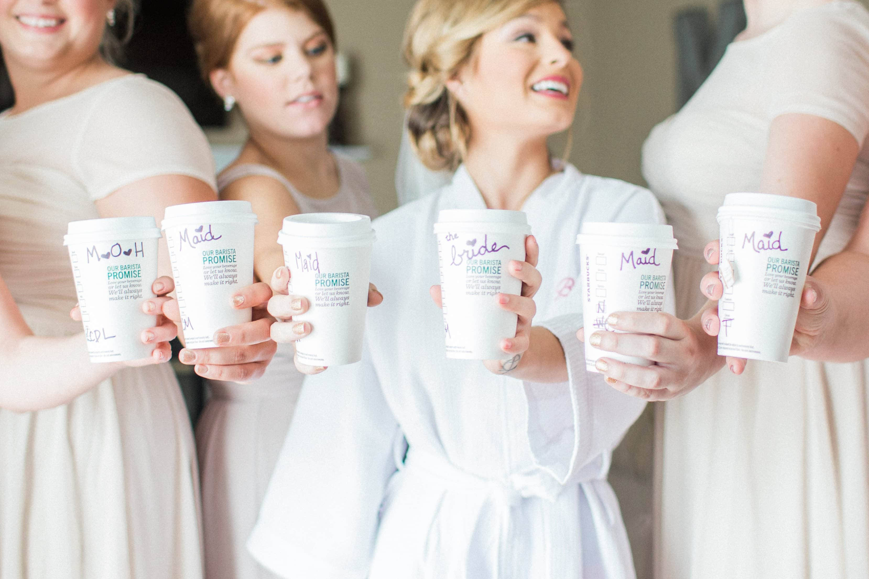 Starbucks coffee cups with bride and bridesmaids
