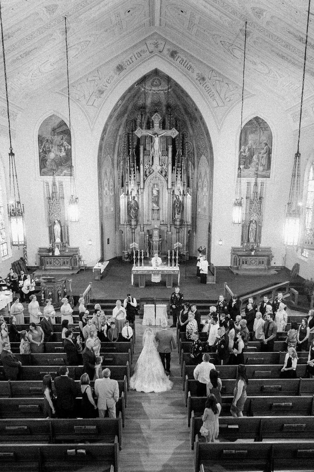 Bride walking down the aisle in church
