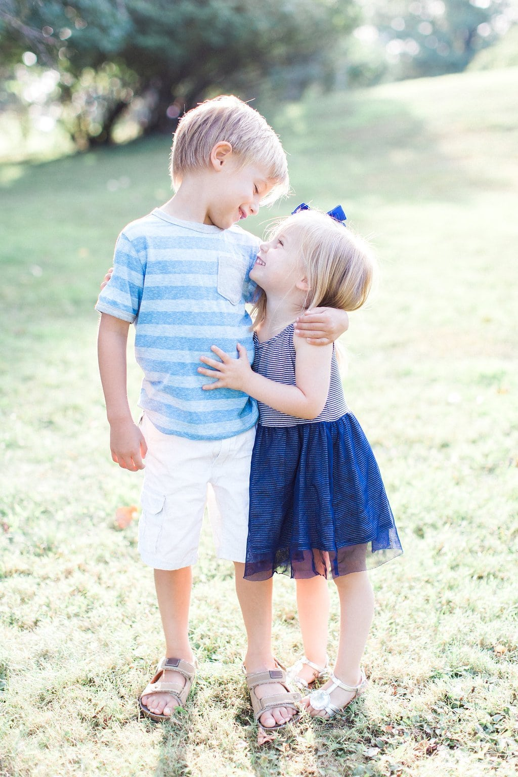 brother and sister hugging each other