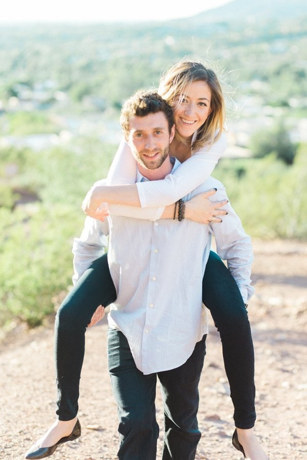 Man giving woman a piggy back ride during portraits