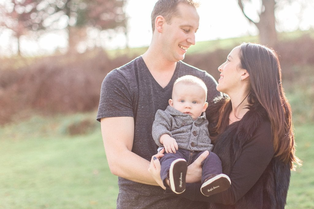 Family of three taking fall photos in Frick Park