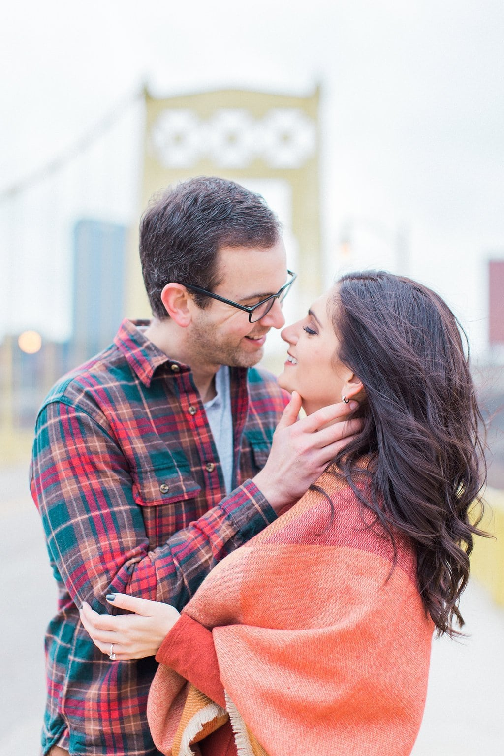 Couple embracing to kiss during portraits