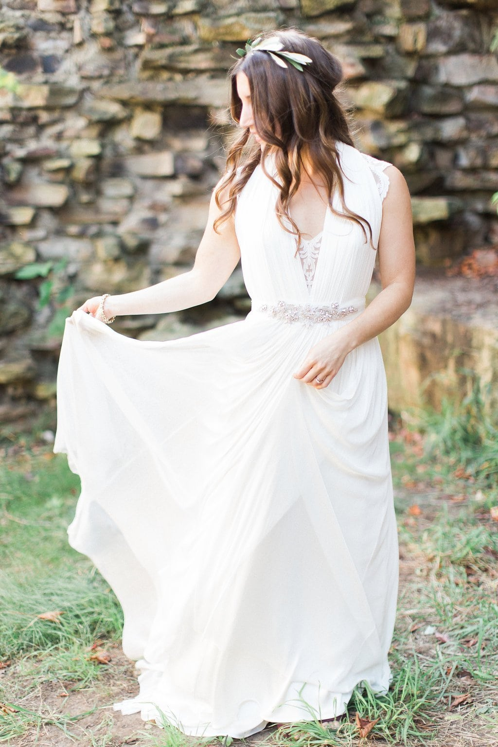 Bride dancing in her lace BHLDN dress