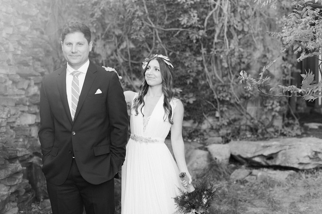 Black and white photo of bride and groom first look