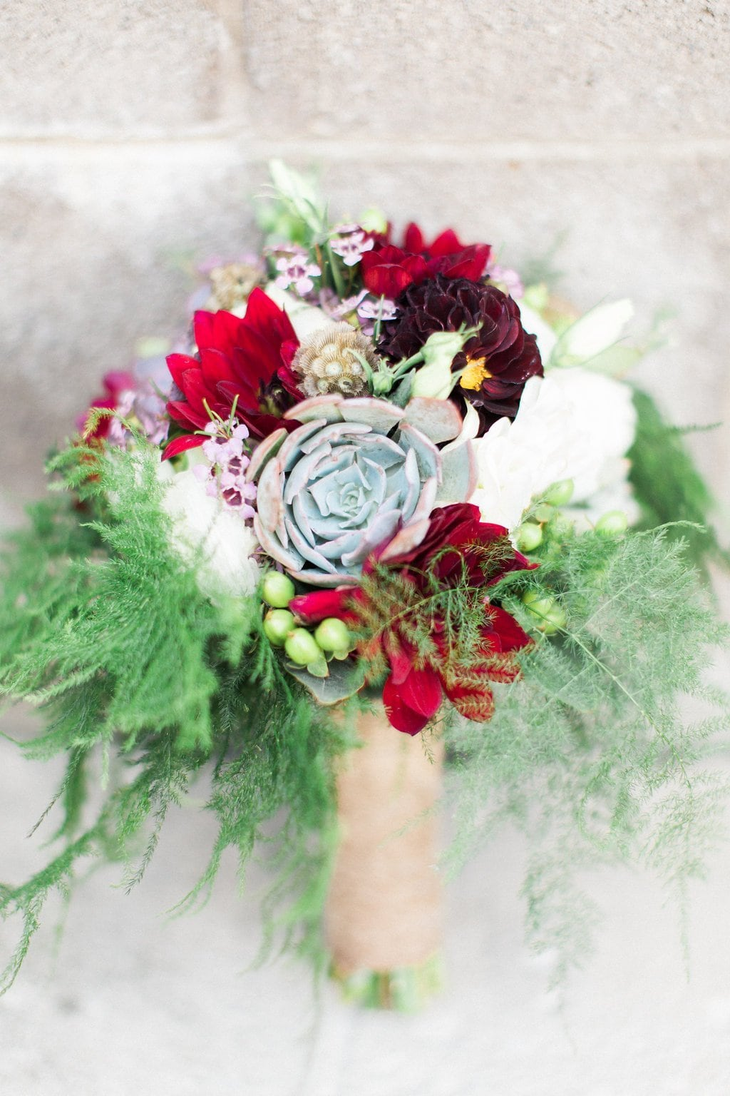 Burgundy, red, and purple bridal bouquet with succulents