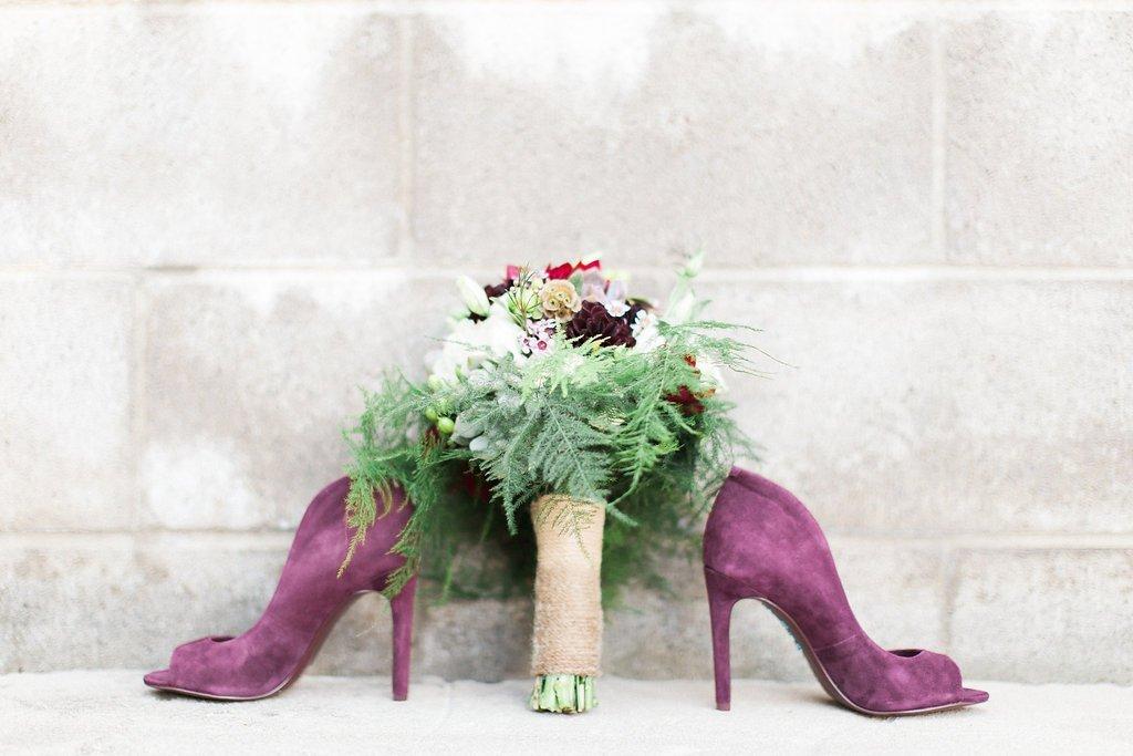 Purple velvet shoes with bride's purple bouquet