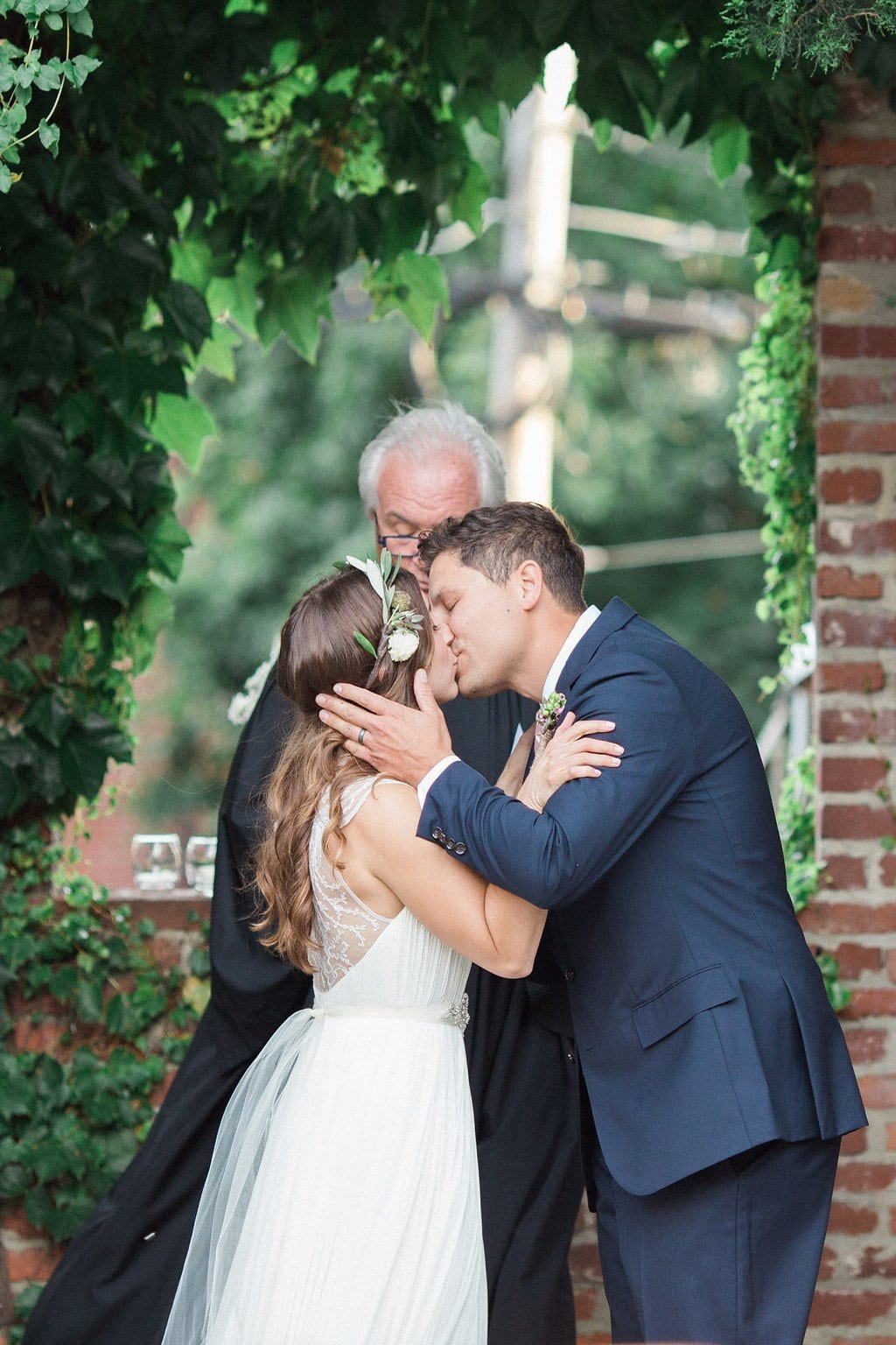 Bride and groom have their first kiss as husband and wife during wedding ceremony