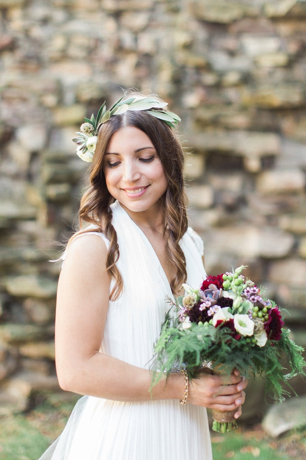 Bride in boho chic BHLD dress with eucalyptus flower crown and purple bouquet