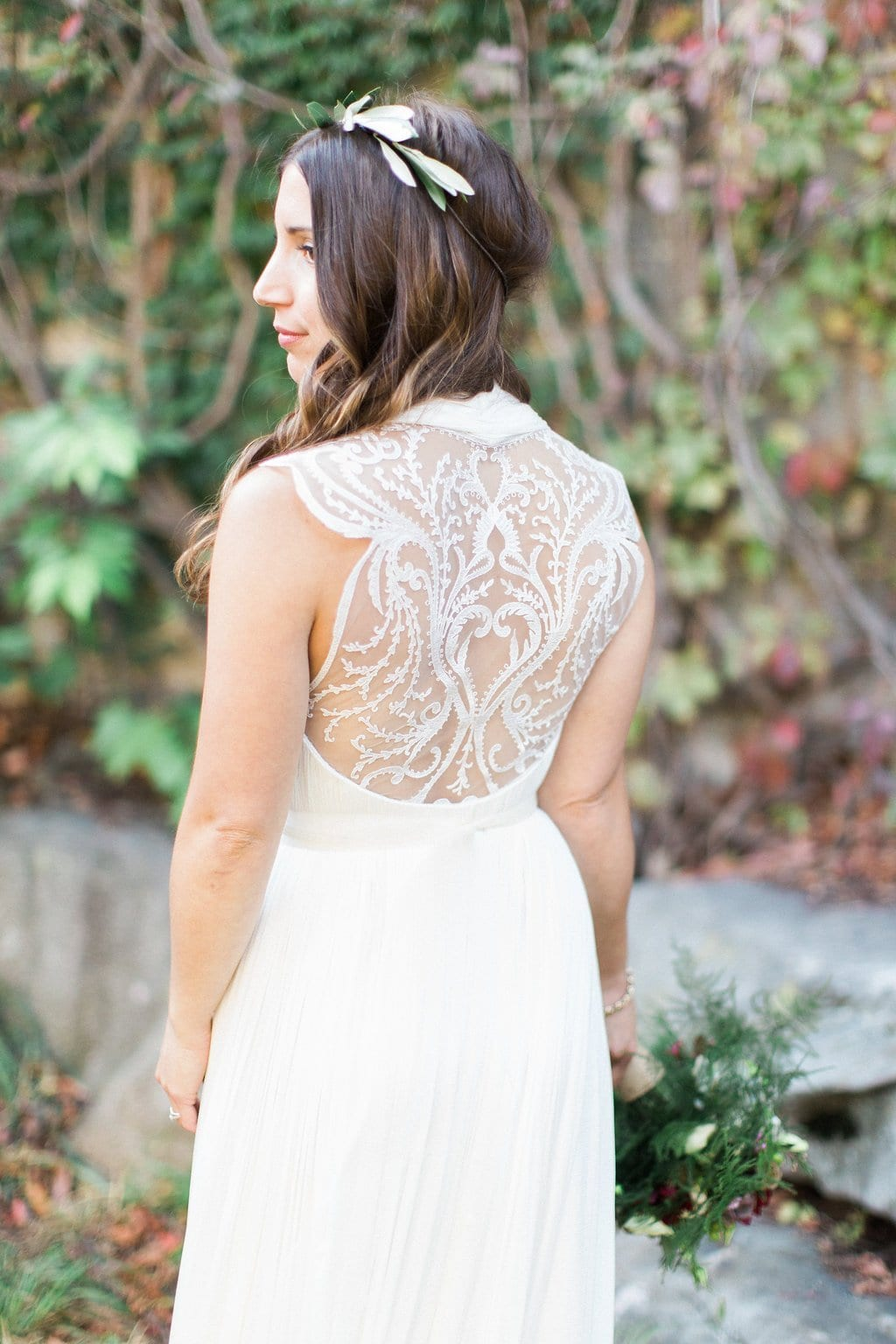 Portrait of bride wearing BHLDN wedding dress showing her back with sheer lace details
