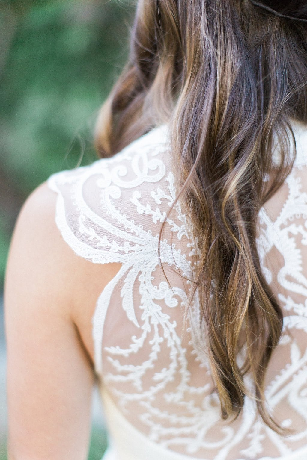 Close up of bride's back and shoulder to show off lace from BHLDN dress