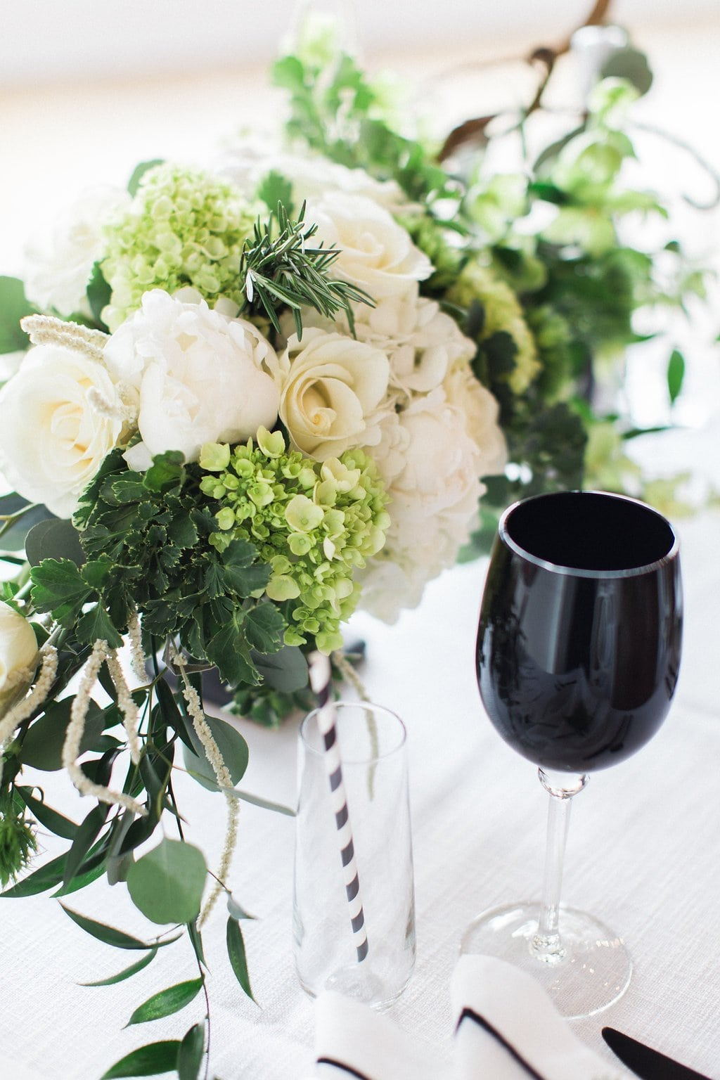 white and green florals with black wine glass