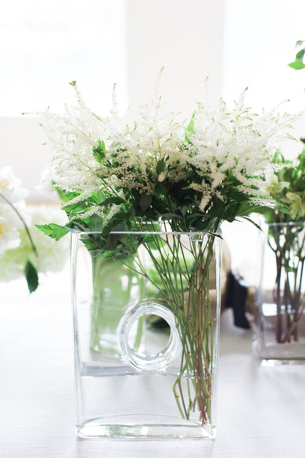 white flowers in a clear glass vase