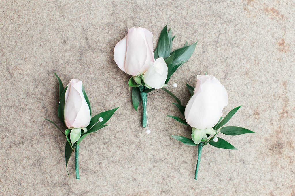 pink roses for groom's boutonnières