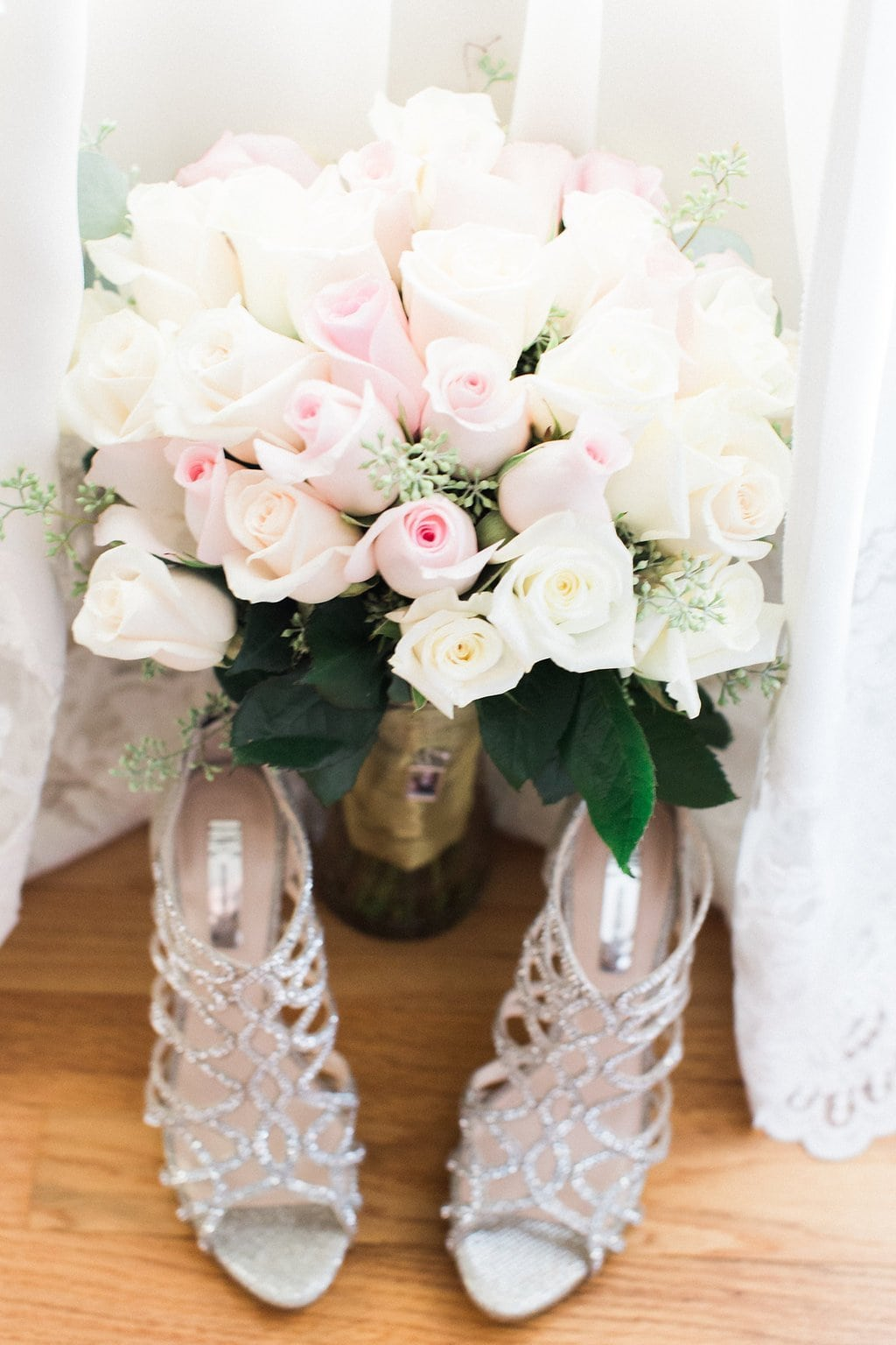 Bride's pink and white bouquet with shoes and wedding dress