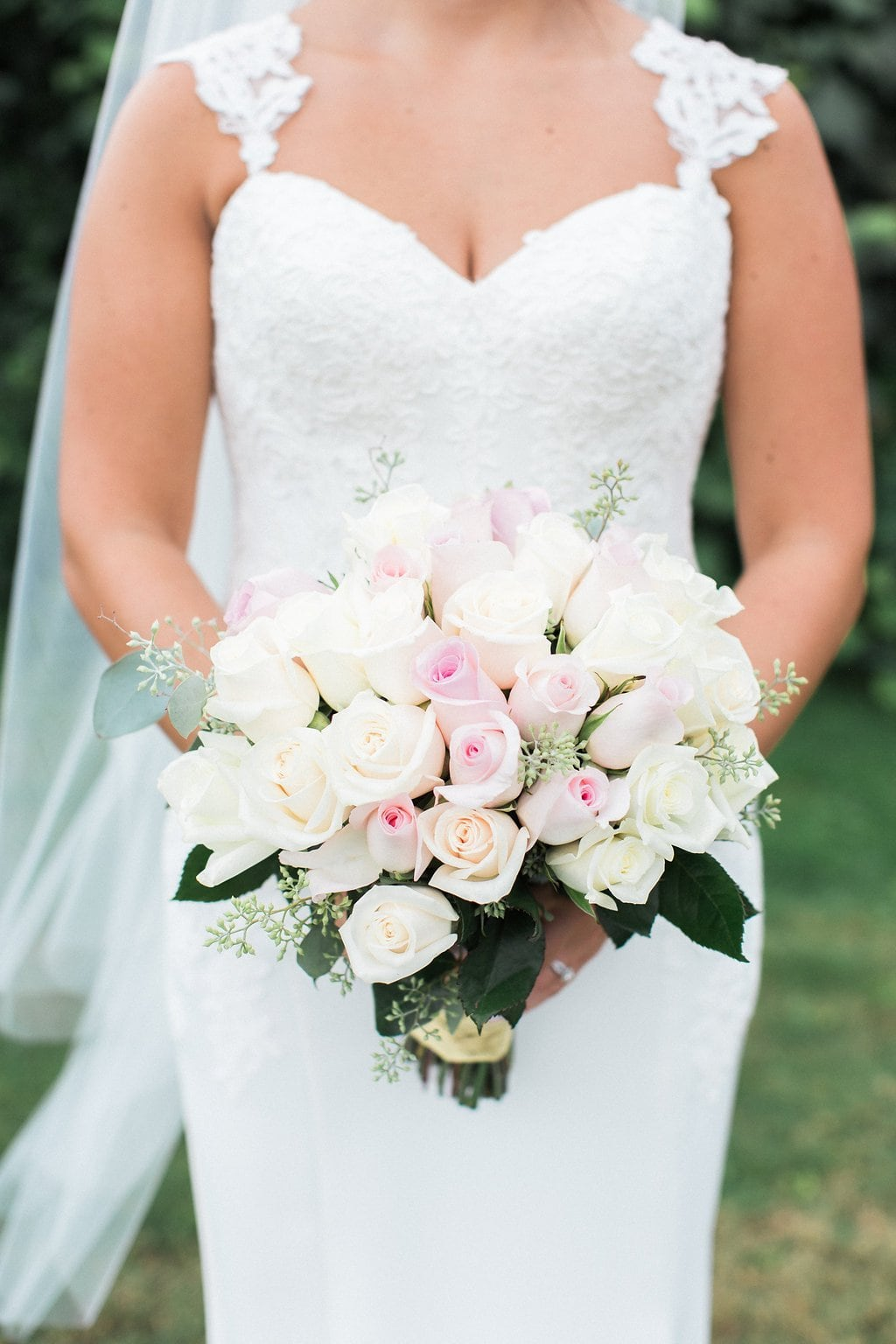Close up of bride holding her pink and white bouquet
