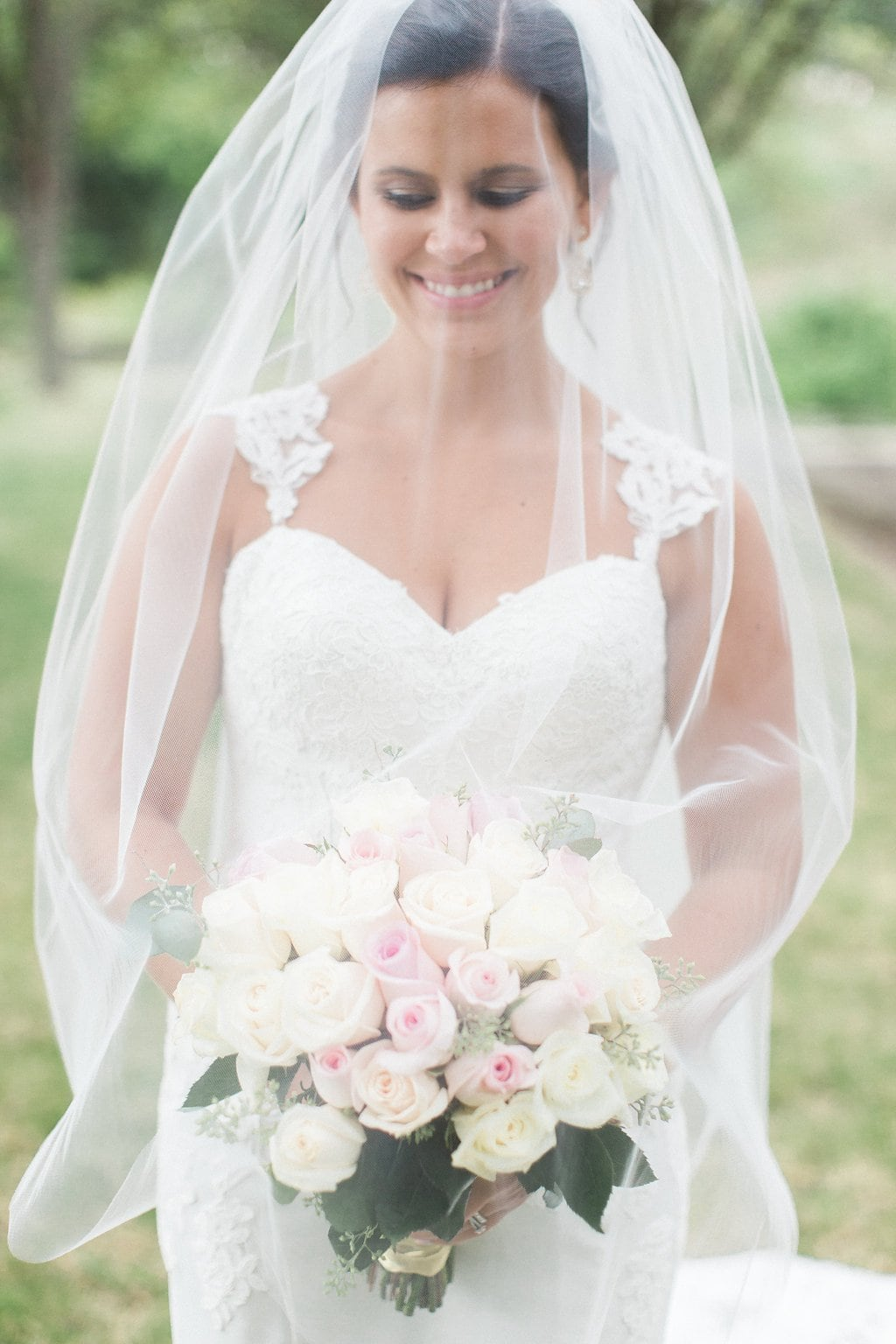 Bride with veil over her face and bouquet
