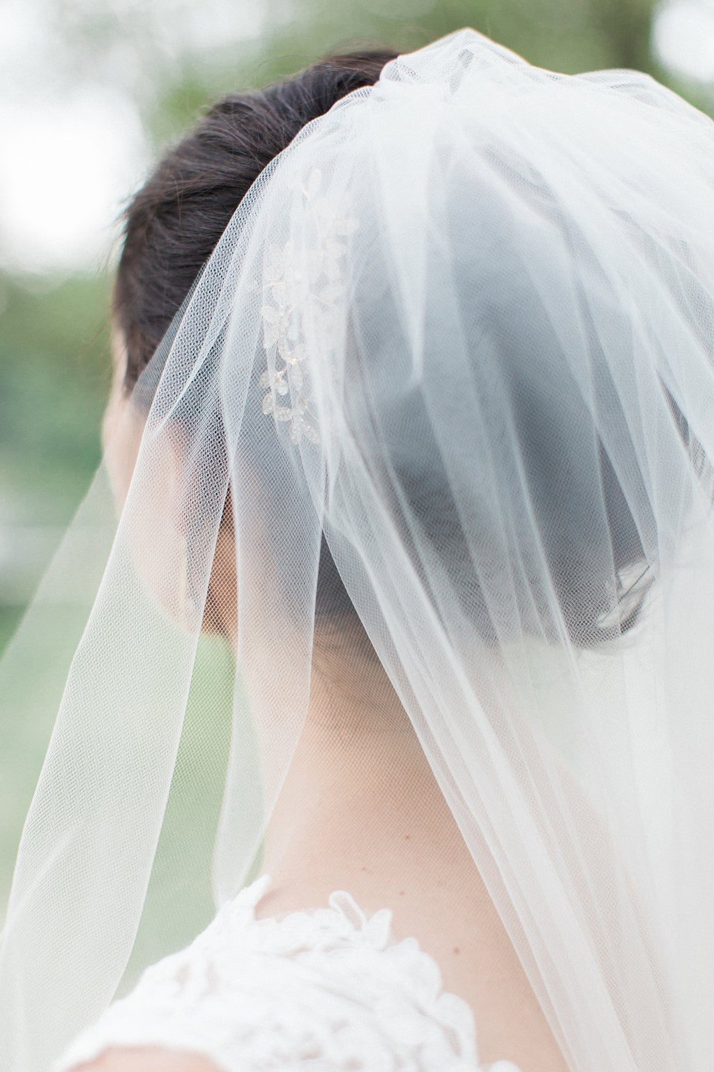 Close up of bride's veil from behind