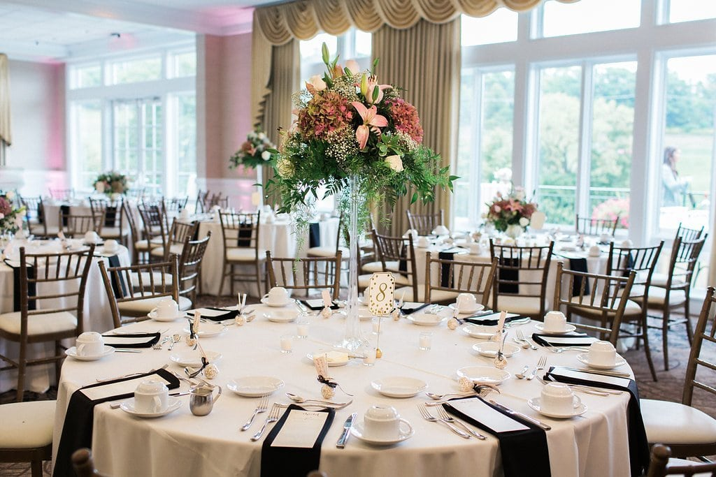 High center pieces with pink flowers at reception