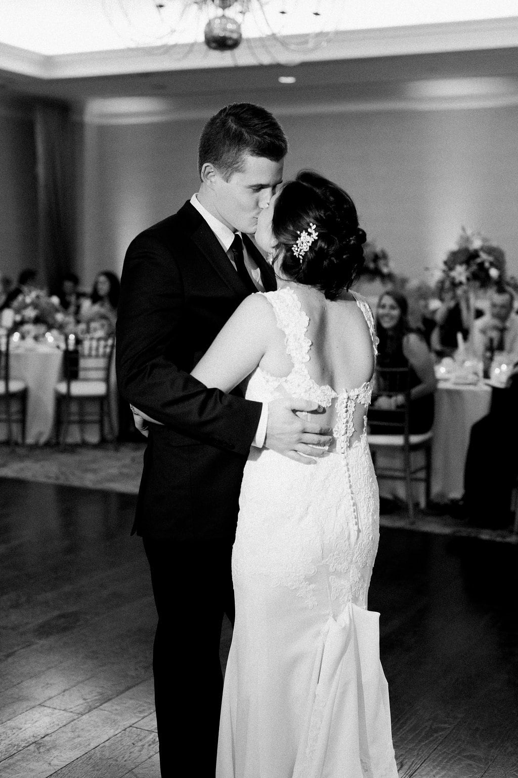 Black and white photo of bride and groom having their first dance