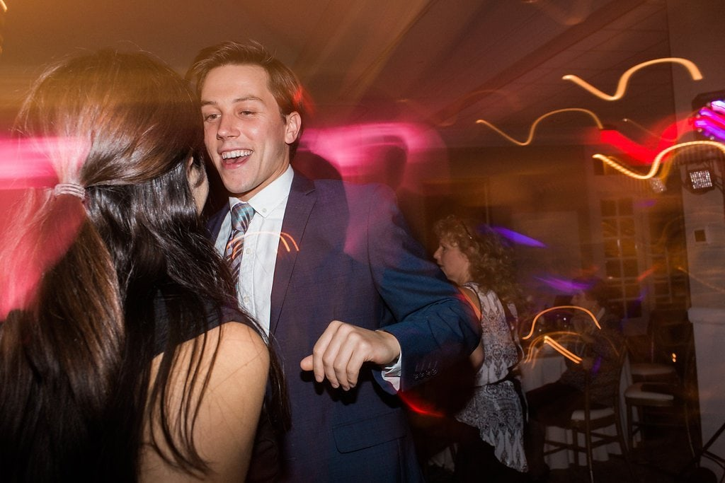 Guests dancing and partying at wedding reception