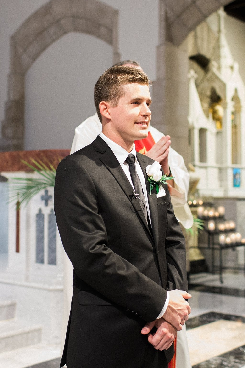 Groom seeing his bride walking down the aisle
